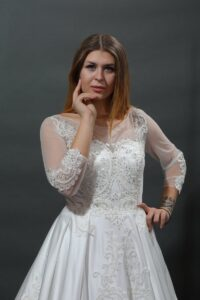 Long sleeve wedding dress with lace and rhinestones